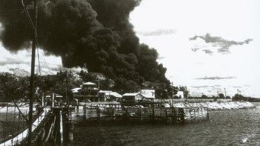 Burning oil tanks following Japanese raid on Darwin, 1942