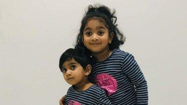 Tharunicaa, left, is pictured with her four-year-old sister Kopika.