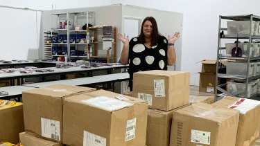 Karen Edbrooke has hardly any staff to unpack the mountain of boxes containing new stock.