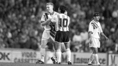 Robbie Slater - aka El Colorado - embraces Diego Maradona after the 1-1 draw in Sydney.