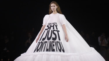 "A model wears a gown with the slogan ""I'm not shy I just don't like you"" at the Viktor & Rolf show at Paris Couture Week."