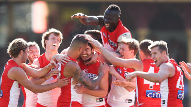 The return: The Swans mob Lance Franklin after scoring a major.