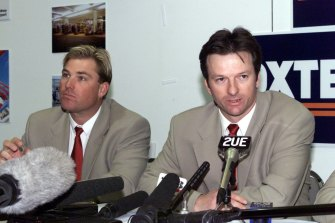 Frosty: Steve Waugh, right, and Shane Warne, left, at a press conference in 1999.