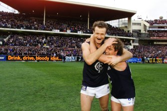 Carlton's Matthew Allan and Fraser Brown celebrate after the win.
