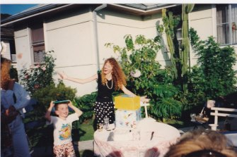 Lisa playing with nephew Leon Spender, 1992.