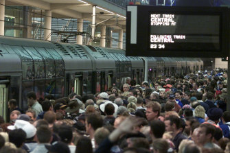 Crowds wait for trains at Olympic Park station on September 23, 2000.