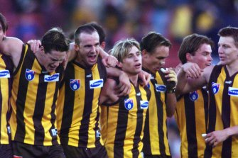 Hawthorn players celebrate after their amazing win.