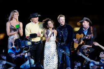 Mixed bag: Elle Macpherson, Greg Norman, Christine Anu, Savage Garden's Darren Hayes and Slim Dusty at the closing ceremony.