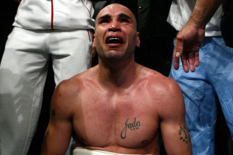 Raw emotion: Mundine breaks down after beating Antwun Echols to claim his first world title in 2003.