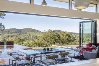 TS Valley Villa Luxury Retreat boasts a large undercover outdoor deck area with custom-built solar-heated pool, outdoor fireplace, and large sun deck overlooking the Yarra Valley and beyond.
