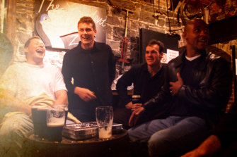Phil Kearns, Jason Little, Nathan Grey and  George Gregan share a joke during their visit to the Guinness brewery.