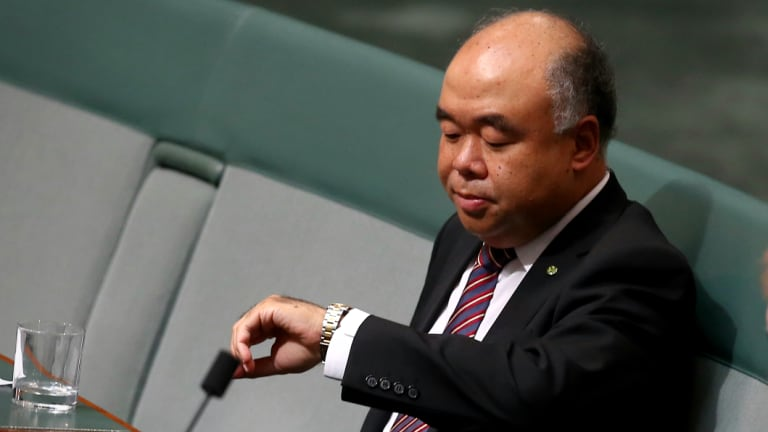 Liberal MP Ian Goodenough checks the time in parliament. Eyebrows have been raised over his off-topic LinkedIn posts.