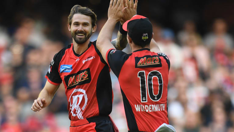 Kane Richardson of the Renegades, left, reacts after dismissing Alex Doolan of the Hurricanes.