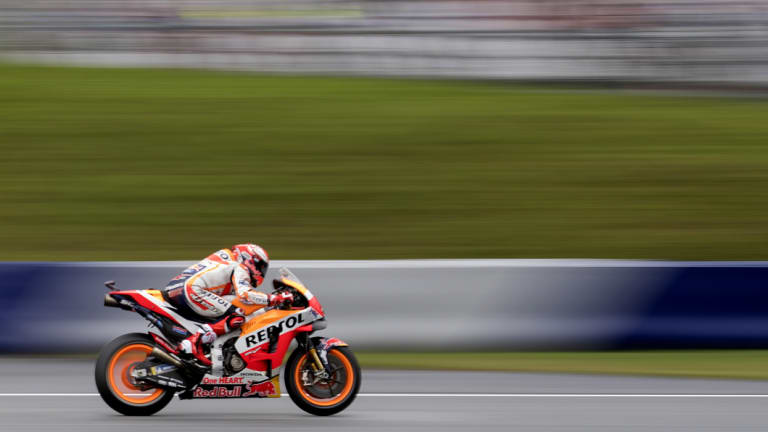 No margin for error: Marc Marquez took the pole by only 0.002 seconds.