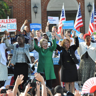 Hillary Clinton on the campaign trail in 2016 with mothers of children killed by gun or police violence. Lucy McBath is to the right of Clinton.