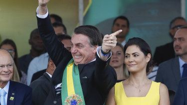 Brazil's President Jair Bolsonaro attends an Independence Day military parade accompanied by first lady Michelle Bolsonaro in Brasilia earlier this month.