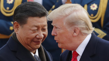 Presidents Xi Jinping and Donald Trump in Beijing last year. China has hit back at the US over trade tariffs.