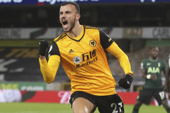Romain Saiss of Wolves celebrates after snatching a point against Tottenham.