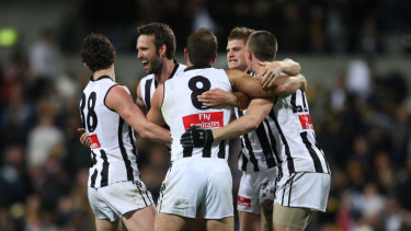 The Magpies celebrate their extra-time victory over the Eagles in 2007.