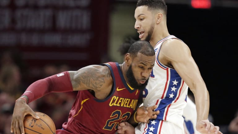 LeBron James and Ben Simmons in NBA action.