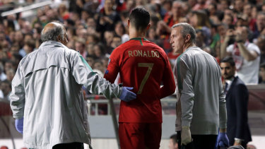 Cristiano Ronaldo leaves the pitch injured.