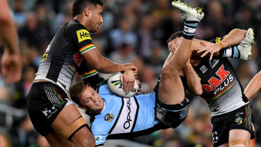 Upended: James Maloney helps Viliame Kikau pick up Matt Moylan, but the Sharks five-eighth had an emphatic win in their personal duel.