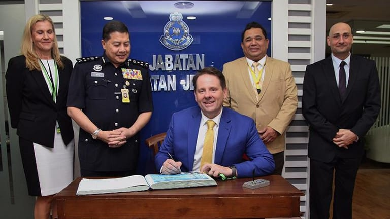 Senior AFP officers with Wan Ahmad Najmuddin bin Mohd on his appointment to the role of criminal investigations director in 2017.