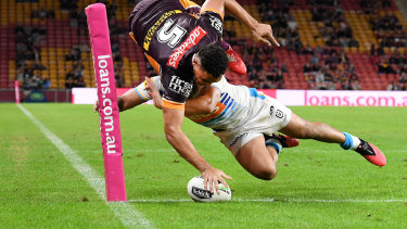Xavier Coates goes over the line for a try that was later disallowed during the round 7 NRL match between the Brisbane Broncos and the Gold Coast Titans.