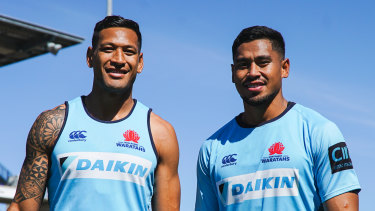 Big brothers: Israel and John Folau pose for a photo before the Waratahs' match against the Sunwolves in round seven.