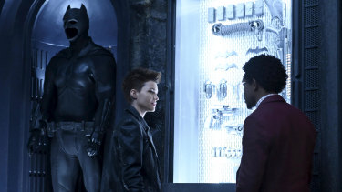 In the shadow of giants ... Kate Kane (Ruby Rose) and Luke Fox (Camrus Johnson) in the Batcave.
