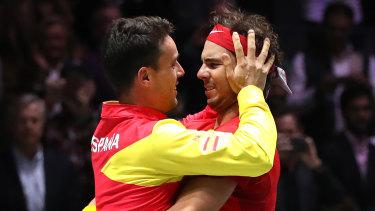Roberto Bautista Agut and Rafael Nadal celebrate Spain's Davis Cup win.