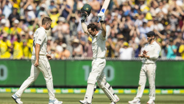 Hats off: Travis Head celebrates his century on day two of the Boxing Day Test.