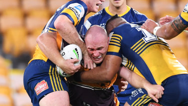 Matt Lodge of the Broncos runs into an Eels brick wall.