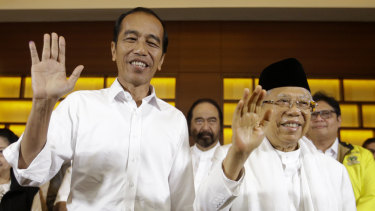 Indonesian President Joko Widodo, left, and his running mate Ma'ruf Amin