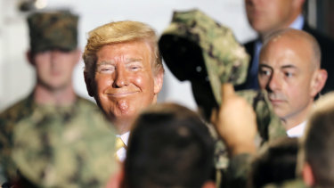 US President Donald Trump greeted US servicemen at the Yokosuka Naval Base on Tuesday.
