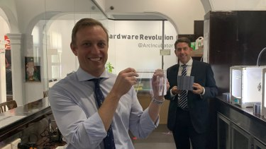 Queensland Health Minister Steven Miles (front) and State Development and Manufacturing Minister Cameron Dick with the components of the newly sourced face shields at the Herston Biofabrication Institute.