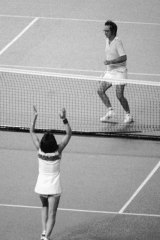 Billie Jean King raises her arms after defeating Bobby Riggs in the 'Battle of the Sexes' in 1973.