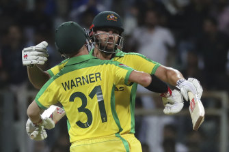 Aaron Finch and David Warner celebrate after winning the opening ODI.