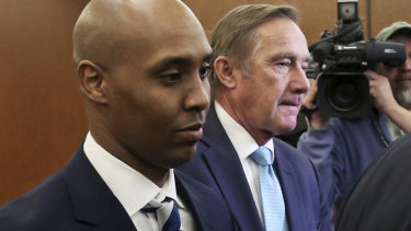 Mohamed Noor, left, former Minneapolis police officer, leaves the Hennepin County Government Centre in Minneapolis with attorney Peter Wold in March.