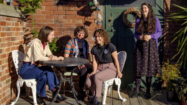 Chilling out: Sophie Jordan, Rachel Deans, Ruthi Hambling, and Julia Earley in the courtyard of Islington's stables.