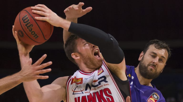 Gimme: Andrew Bogut fouls Brian Conklin to give him a pair of shots from the free-throw line at Qudos Bank Arena.