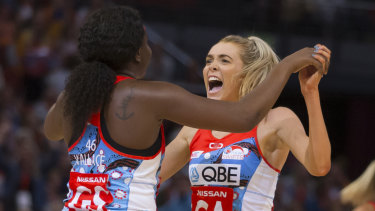 Helen Housby and Sam Wallace celebrate the Swifts comeback win on Sunday over the Giants.