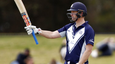 Victoria's Cameron White celebrates his half-century en route to 88 in the JLT Cup final against Tasmania.