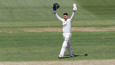 Nick Maddinson celebrates his century.