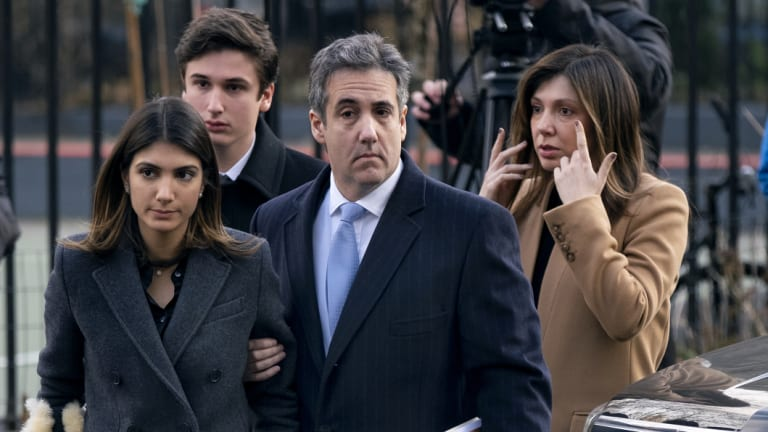 Michael Cohen arrives at a New York court on Wednesday with his wife (right) and two children.