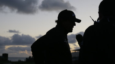 Phil Mickelson talks with reporters at Pebble Beach after play was halted for the second time.