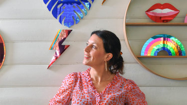 Miranda Moreira, founder of Bride & Wolfe in her studio with her signature circular shelving and mirrors.