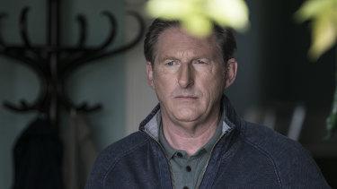 Adrian Dunbar plays Jim Hogan in Blood.