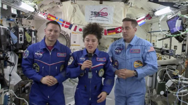 US astronaut Jessica Meir speaks, accompanied by Andrew Morgan and Chris Cassidy, during a news conference held by the American members of the International Space Station.
