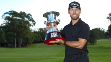 Bryden Macpherson poses with the trophy after winning the NSW Open.